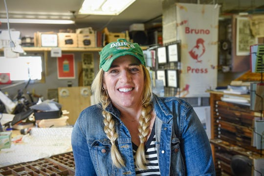 Mary Bruno poses for a photo on Friday, May 17 in her St. Joseph letterpress print shop. She supports a legislative proposal to create a state-run paid leave program.