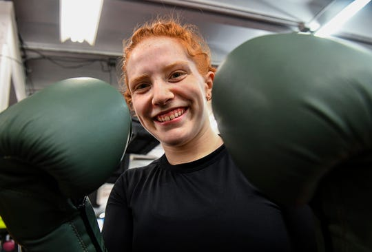 Annabel Kelly takes a moment to pose for a photograph during a training session  Wednesday, May 15, at the St. Cloud Boxing & Wrestling Club in St. Cloud.