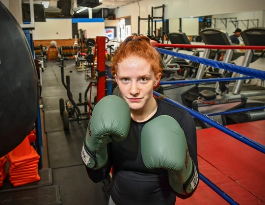 Annabel Kelly poses for a photograph while training Wednesday, May 15, at the St. Cloud Boxing & Wrestling Club in St. Cloud.