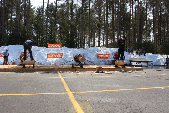 Rainer Shooter, right, competes in the underhand cut discipline during the 2018 STIHL TIMBERSPORTS Collegiate Championship.