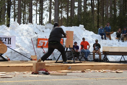 Rainer Shooter competes in the standing block chop discipline in the 2018 STIHL TIMBERSPORTS Collegiate Championship.