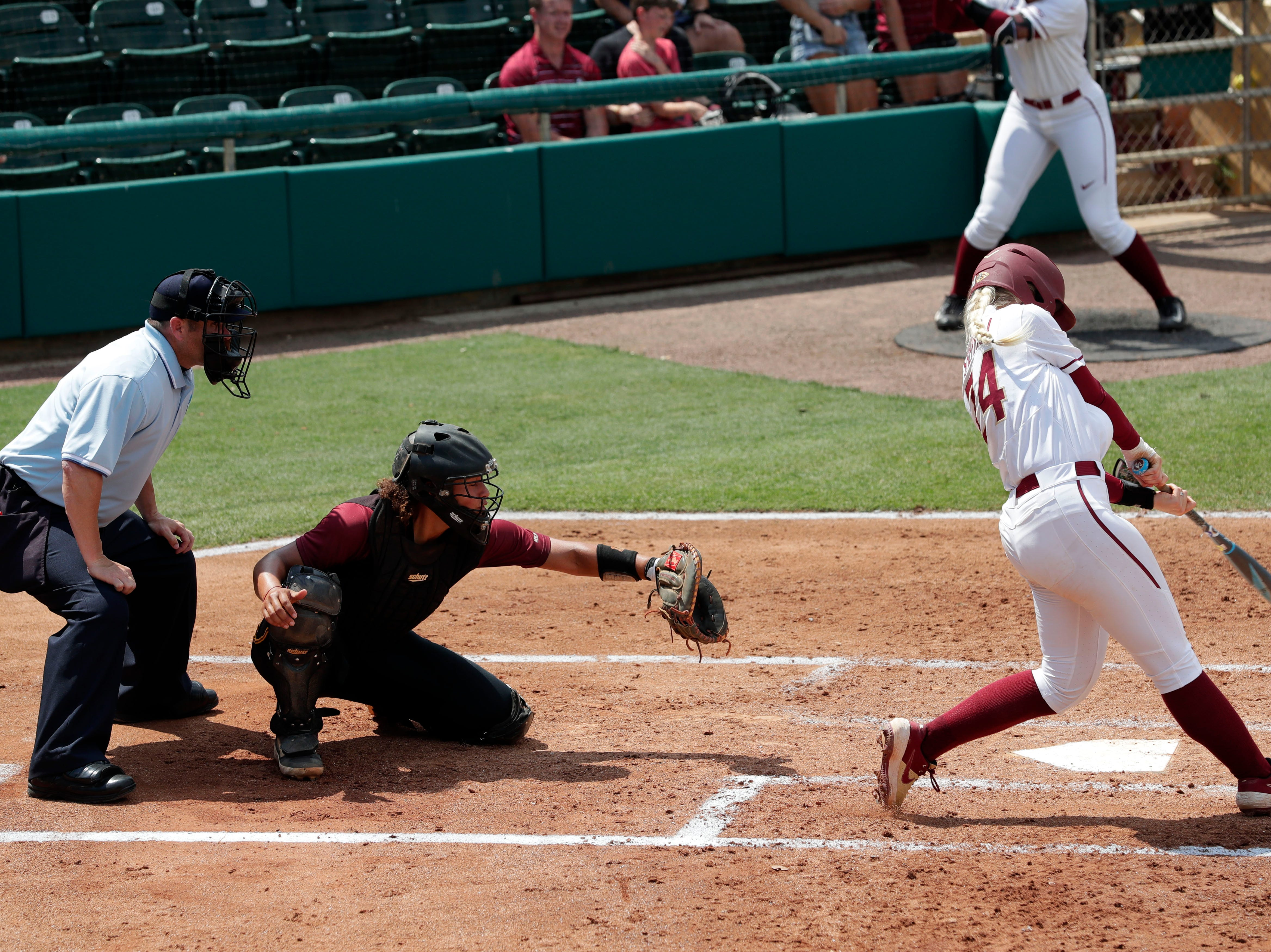 Florida State Seminoles utility player Sydney Sherrill (24) gets a hit. The Florida State Seminoles host the Bethune-Cookman Wildcats in the first round of the NCAA Regional Playoffs Friday, May 17, 2019.