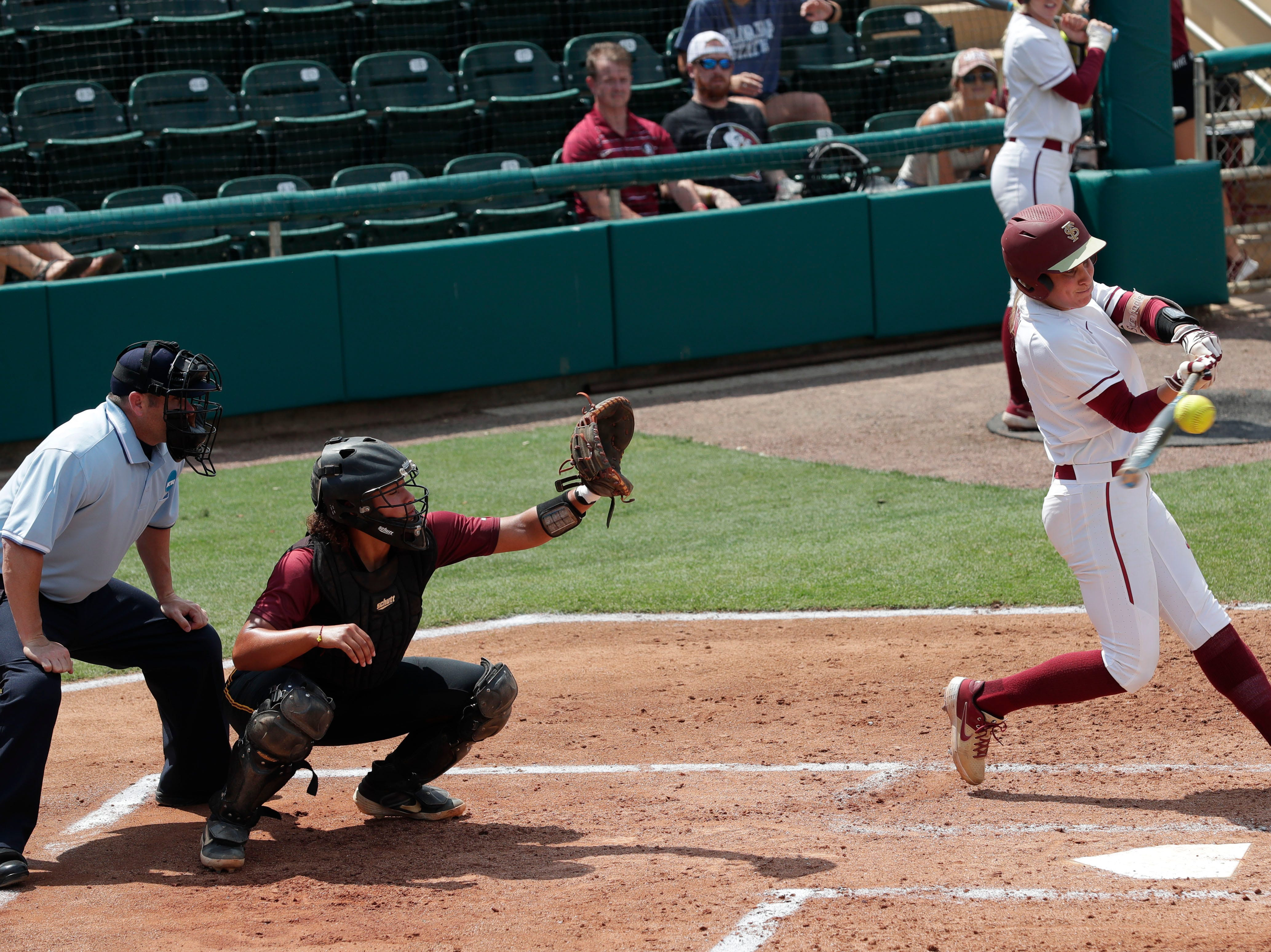 Florida State Seminoles infielder Carsyn Gordon (12) gets a hit. The Florida State Seminoles host the Bethune-Cookman Wildcats in the first round of the NCAA Regional Playoffs Friday, May 17, 2019.
