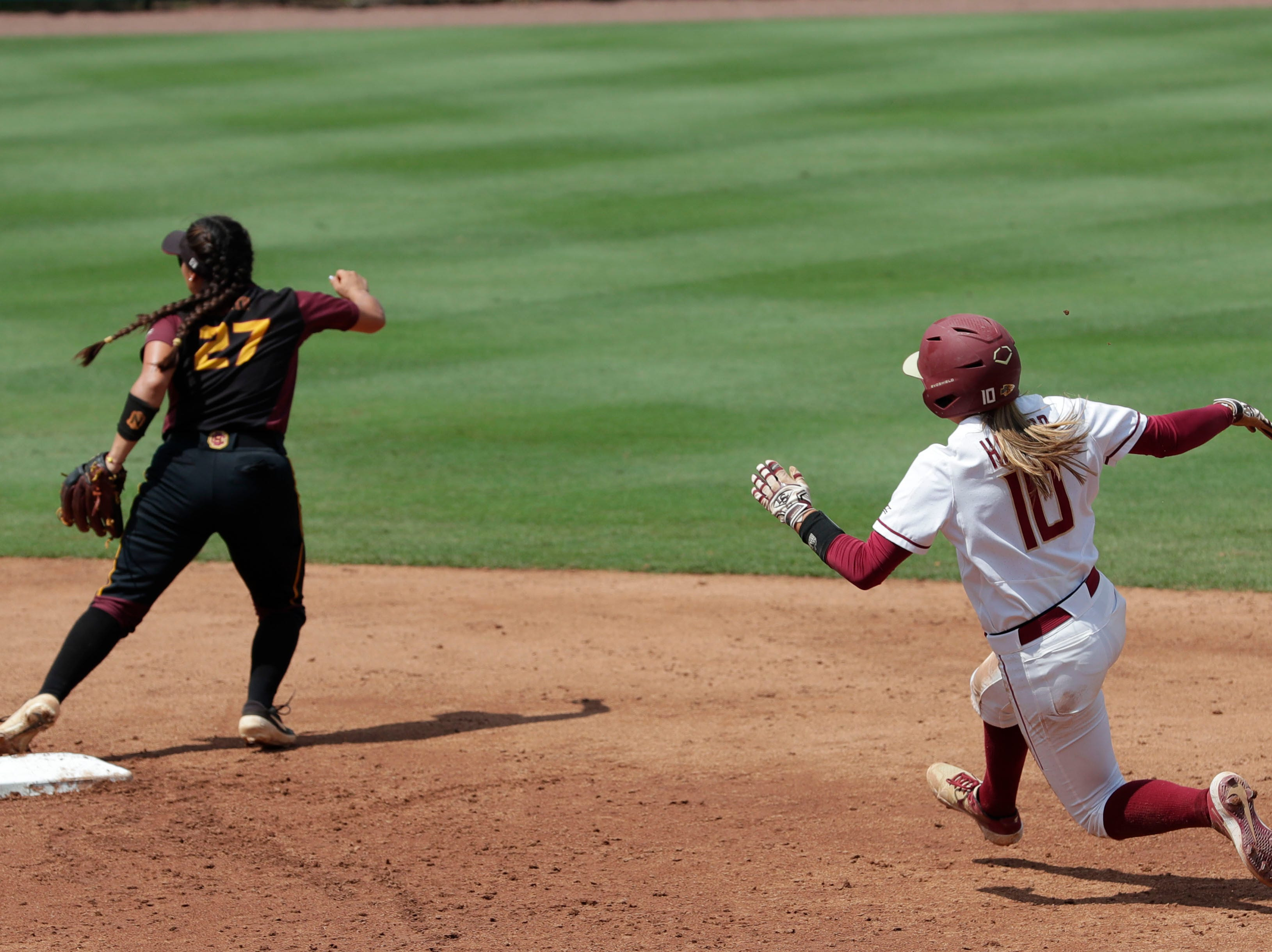 Florida State Seminoles infielder Cali Harrod (10) slides into second base. The Florida State Seminoles host the Bethune-Cookman Wildcats in the first round of the NCAA Regional Playoffs Friday, May 17, 2019.