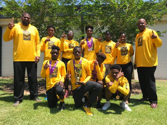 Nims Middle School boys' track & field team won the 2019 state championship. From left to right (Back Row): Jeffery Sims (head coach), Danny Anderson, David Laws, Travis Morris, Sheldon Richardson, Shanya Charles (assistant coach) and Daron Parrish (assistant coach). Front Row: Daijoel Feaster, Kaveon Ruffin, Zanario Travis and Le'Kel Manna.