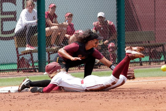Florida State Seminoles infielder Cali Harrod (10) steals third base. The Florida State Seminoles host the Bethune-Cookman Wildcats in the first round of the NCAA Regional Playoffs Friday, May 17, 2019.