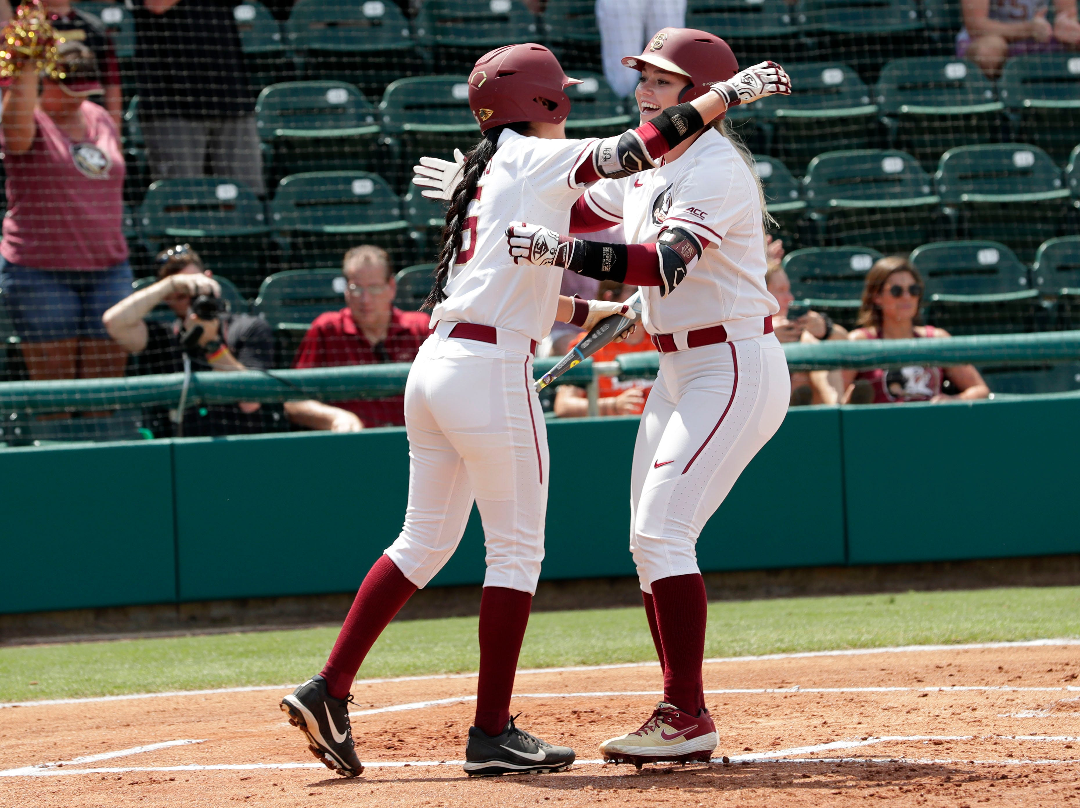 Florida State Seminoles outfielder Zoe Casas (6) hugs Florida State Seminoles starting pitcher/relief pitcher Cassidy Davis (70) after Davis scores a home run. The Florida State Seminoles host the Bethune-Cookman Wildcats in the first round of the NCAA Regional Playoffs Friday, May 17, 2019.