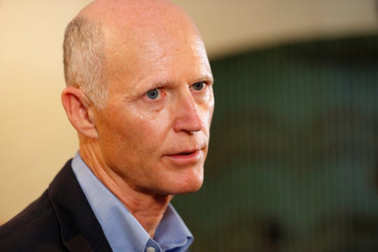 "Senator Rick Scott, R-Fla., speaks to members of the media, Monday, April 15, 2019, at El Porton de la Flaca Colombian restaurant in Doral, Fla. Scott has proposed a ""Make Washington Work"" package."