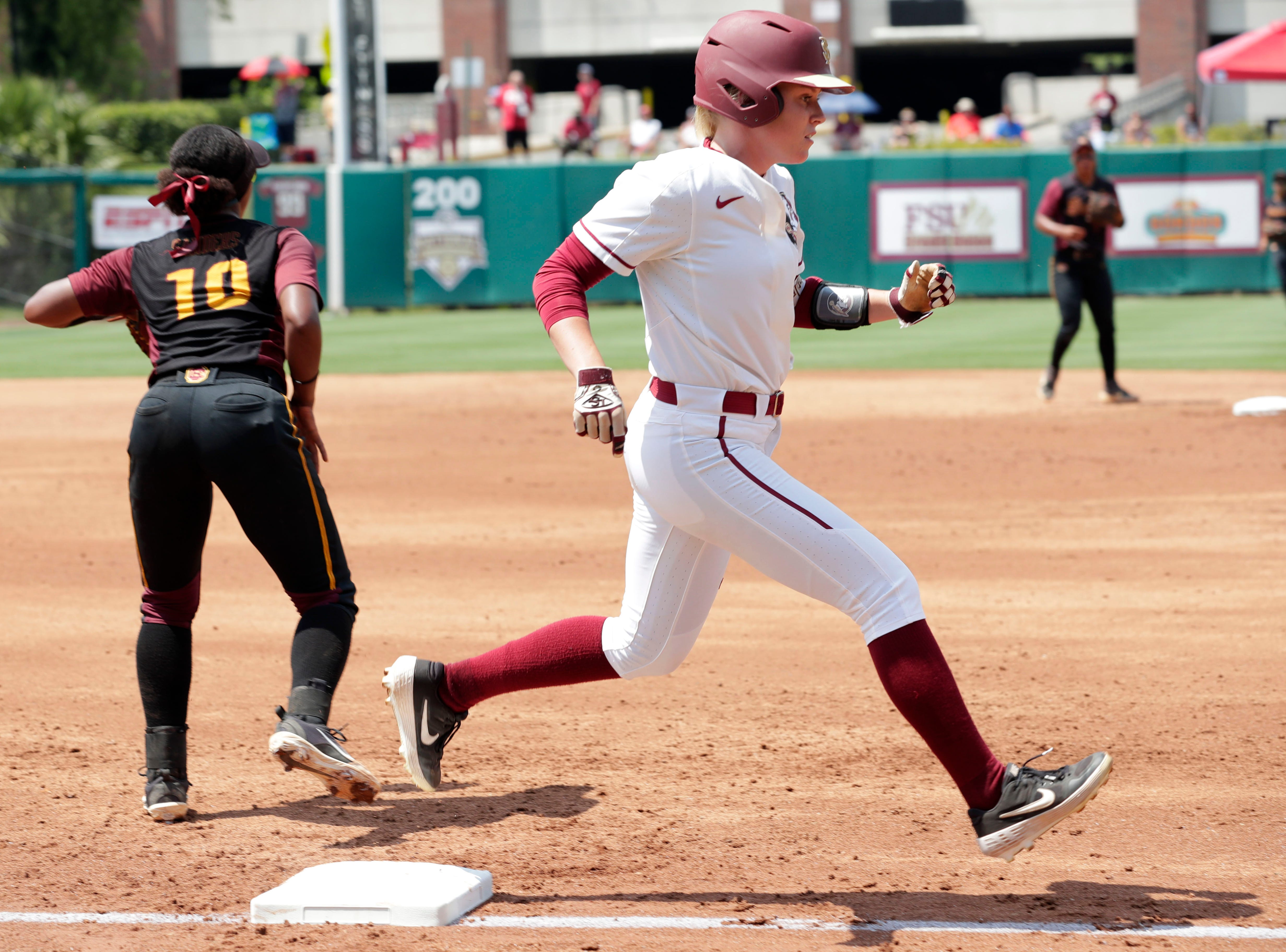 Florida State Seminoles infielder Dani Morgan (1) gets tagged out at first base. The Florida State Seminoles host the Bethune-Cookman Wildcats in the first round of the NCAA Regional Playoffs Friday, May 17, 2019.