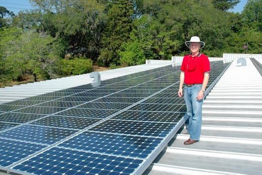 Jack showing off his new solar panels.