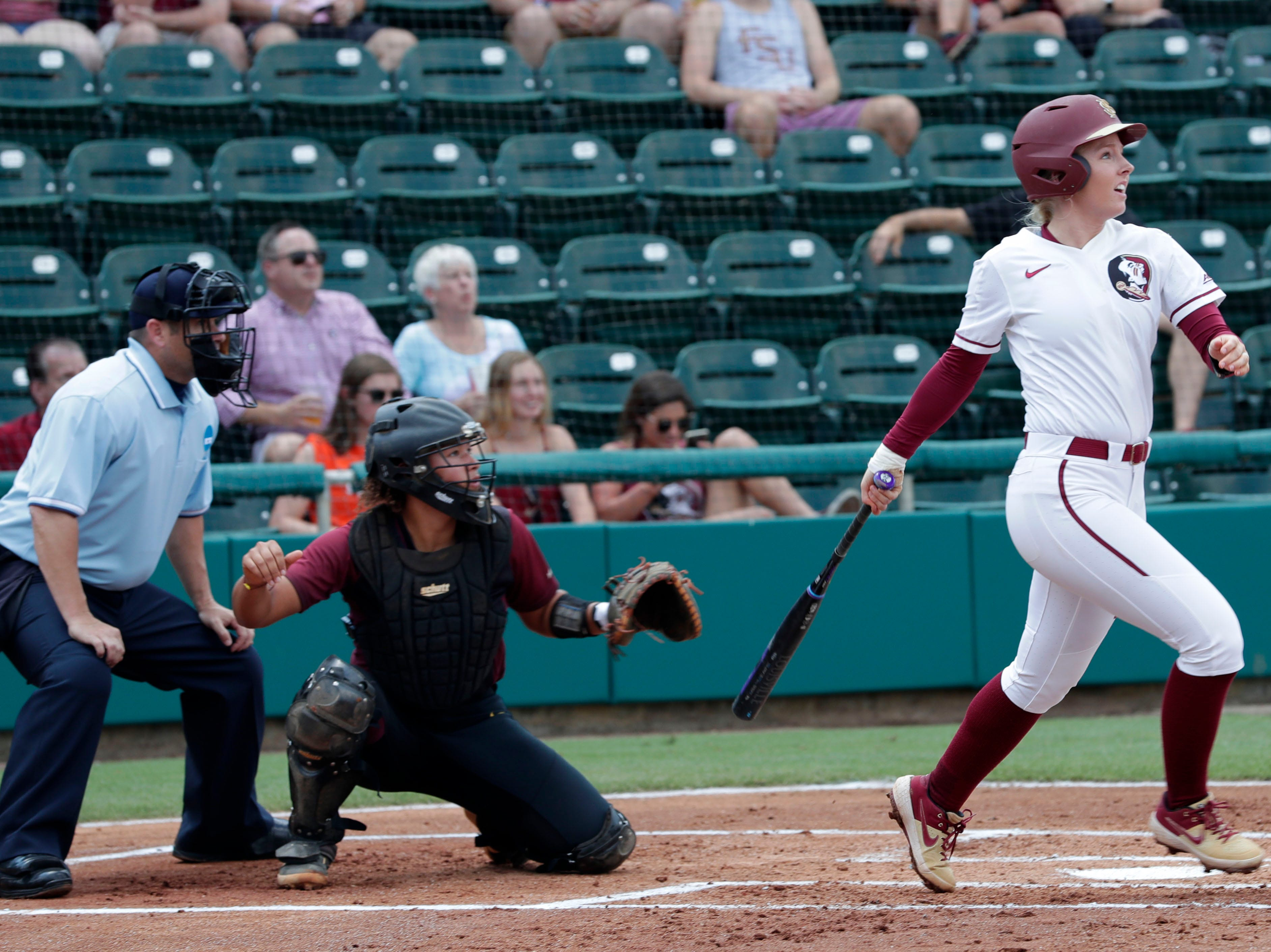 Florida State Seminoles utility player Sydney Sherrill (24) watches as the ball she hits flies to the outfield. The Florida State Seminoles host the Bethune-Cookman Wildcats in the first round of the NCAA Regional Playoffs Friday, May 17, 2019.