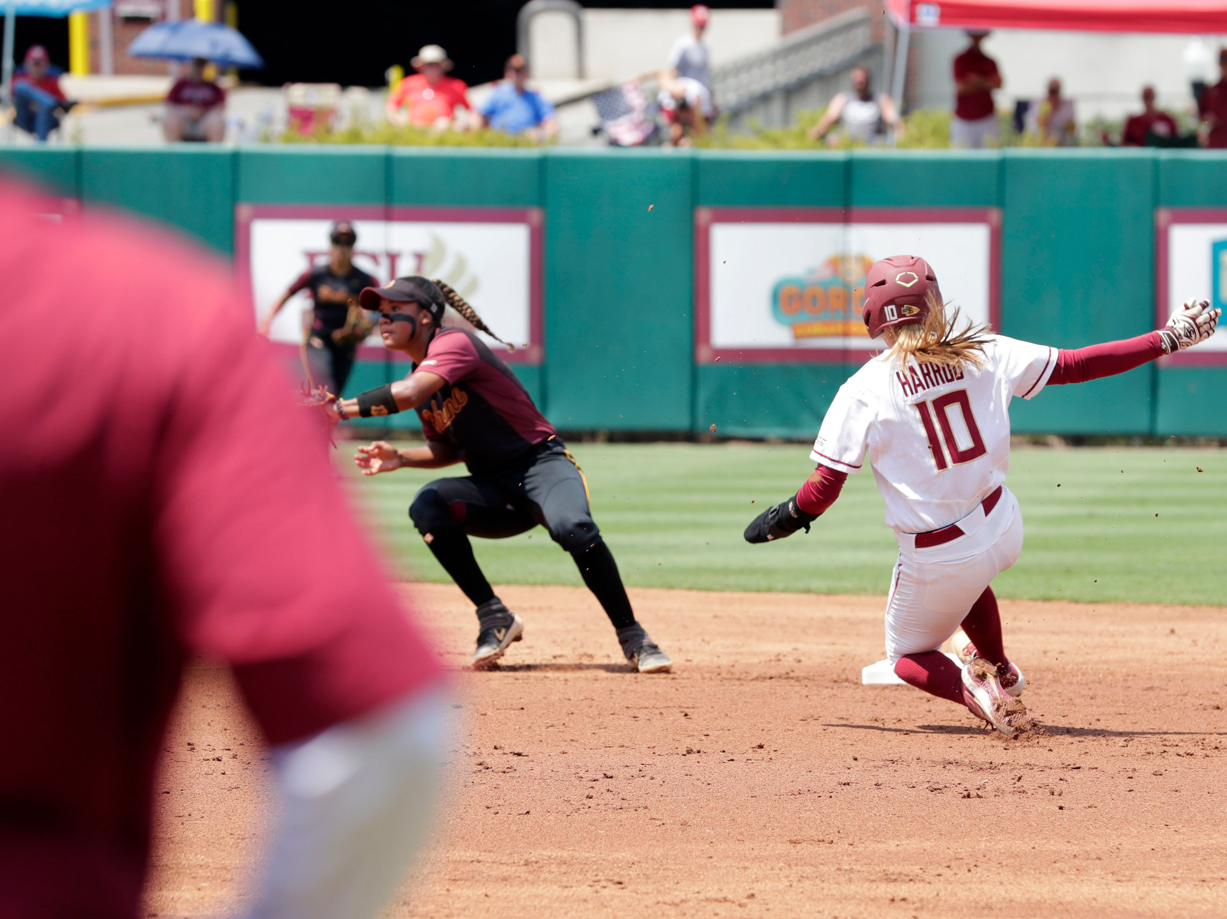 Florida State Seminoles infielder Cali Harrod (10) steals second base. The Florida State Seminoles host the Bethune-Cookman Wildcats in the first round of the NCAA Regional Playoffs Friday, May 17, 2019.