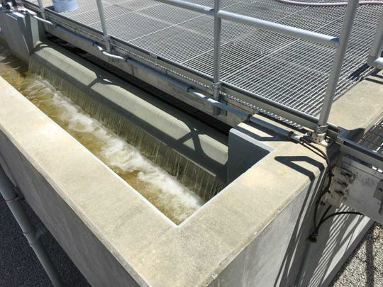 Reclaimed water drops from a sand filter into a chlorine contact chamber at the Glades Wastewater Treatment Plant in Port St. Lucie.