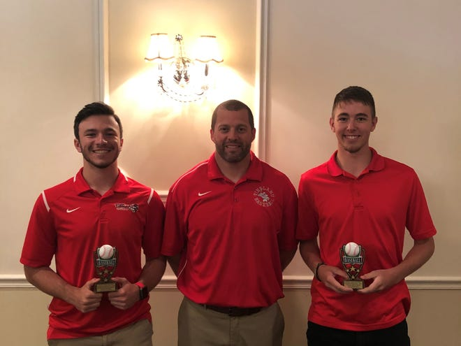 Vineland's Shane Vastano, left, and Zach Reynolds, right, pose with coach Travis Amstutz after winning awards at the recent South Jersey Coaches Association luncheon.