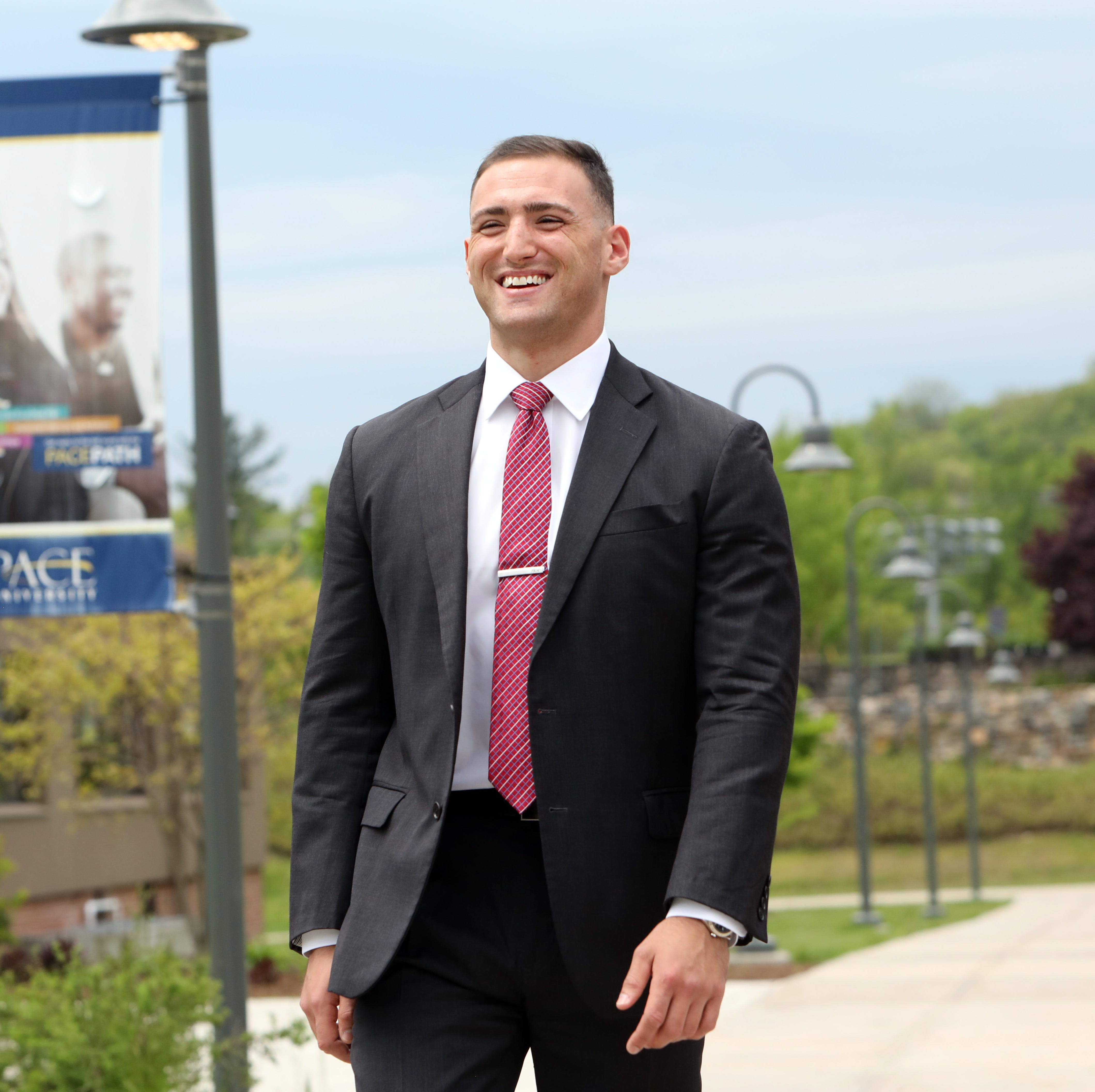 James Hickey, who is graduating from Pace University's Lubin School of Business, on campus before receiving an honors finance award May 17, 2019 in Pleasantville. Hickey lost his father at 11, his mother when he was a senior in high school, followed by their home. He entered the workforce and has lived with friends over the years who he credits for helping him move forward. He now lives in a White Plains and will be graduating from Pace with a 4.0 GPA and a job waiting for him at Merrill Lynch.