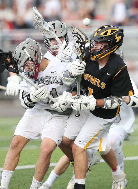 From left, Scarsdale's Oliver Krohn (11) and Lakeland/Panas' Rob Hart (1) battle for ball control during boys lacrosse playoff action at Scarsdale High School May 16, 2019. Lakeland/Panas won the game 8-7.