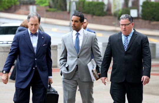 Mount Vernon Mayor Richard Thomas, center, walks with his attorney Mike Pizzi, right, after a court appearance at the Westchester County Courthouse in White Plains, May 17, 2019.