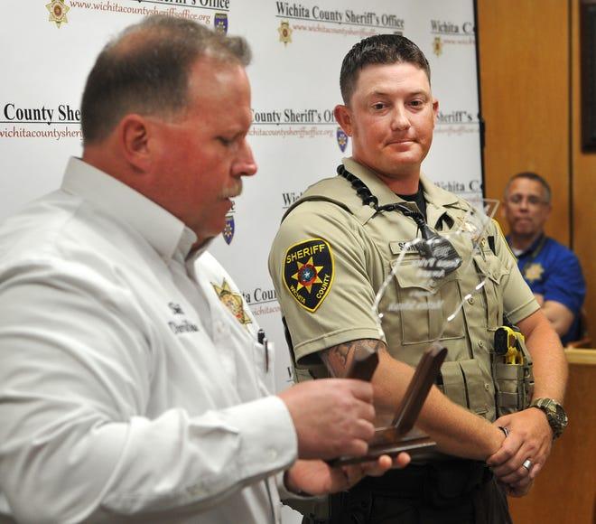 Wichita County Sheriff, David Duke, left, awards deputy Matthew Schenck Tessa Price Award, Thursday during the Wichita County Sheriff's Office Quarterly Award Ceremony.