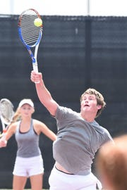 Vernon's BT White reaches for a shot at the net during the Class 4A mixed doubles final at the UIL state championship in College Station on Friday, May 17, 2019. Sarah Castleberry and White won 5-7, 6-0, 6-0 to claim the state title.