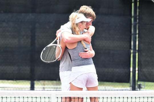 Vernon's BT White hugs Sarah Castleberry after the Class 4A mixed doubles final at the UIL state championship in College Station on Friday, May 17, 2019. Castleberry and White won 5-7, 6-0, 6-0 to claim the state title.