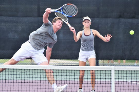 Vernon's BT White hits a shot in front of partner Sarah Castleberry during the Class 4A mixed doubles final at the UIL state championship in College Station on Friday, May 17, 2019. Castleberry and White won 5-7, 6-0, 6-0 to claim the state title.