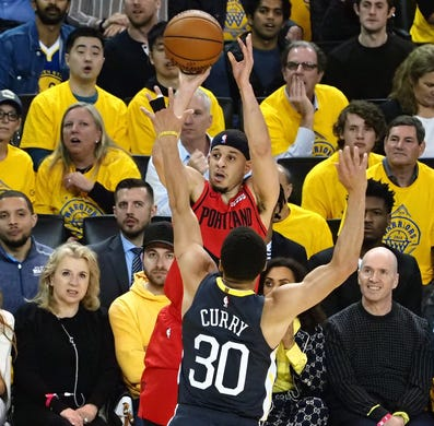 May 16: Blazers guard Seth Curry (31) shoots over his brother Warriors defender Steph Curry (30) during Game 2.
