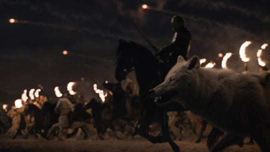 "Ghost, the direwolf of Jon Snow, charges into the fight during the Battle of Winterfell in Season 8's ""The Long Night."""