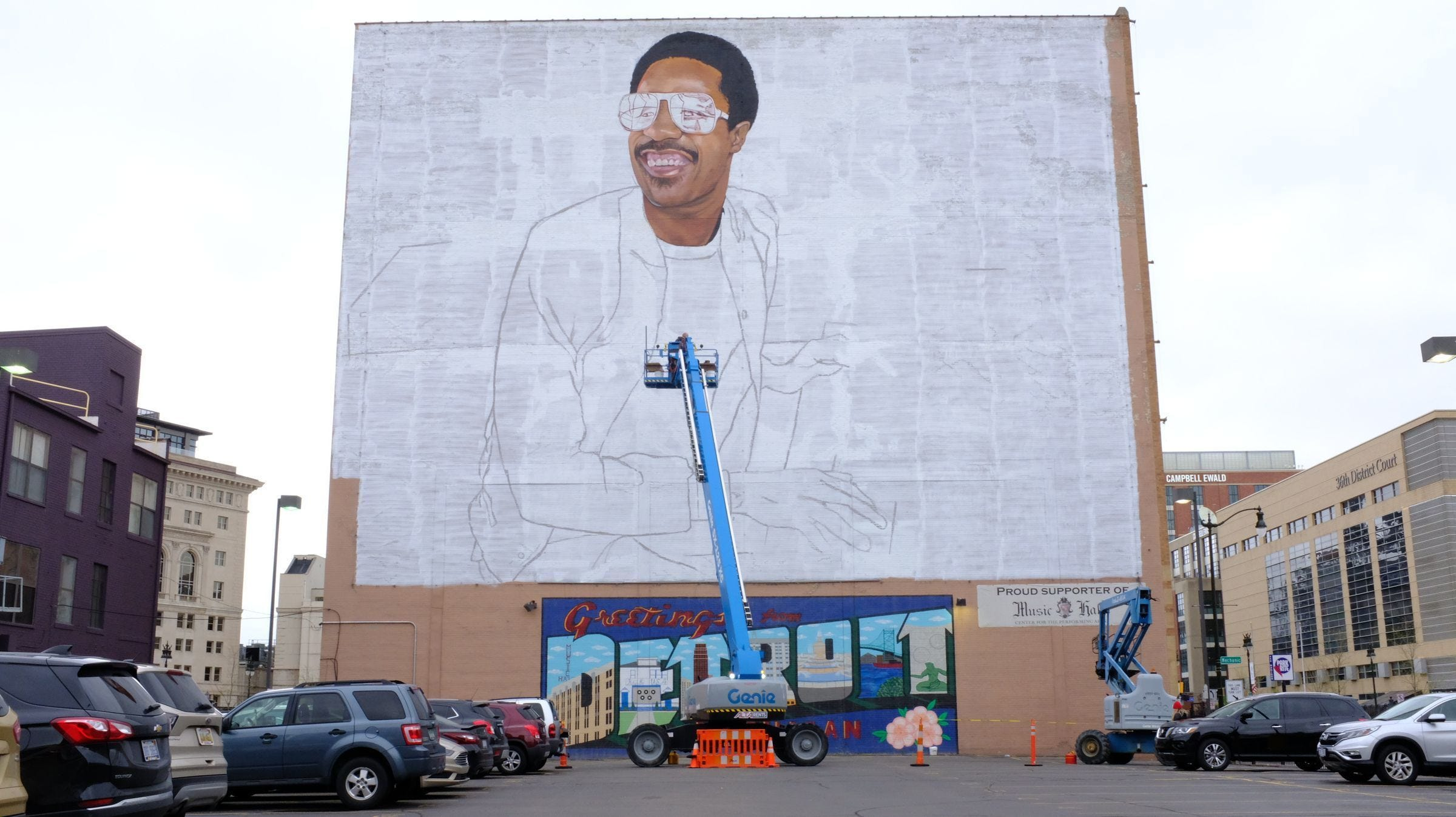 London-based artist Richard Wilson finishes details of Stevie Wonder's face on a new mural being installed on the wall of the Music Hall Center for the Performing Arts in Detroit on Monday.