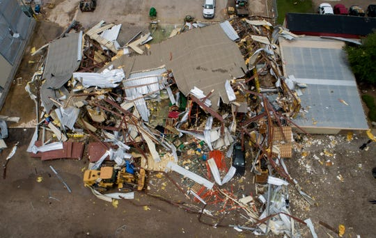 In this aerial photo various debris from McCourt & Sons Equipment Inc. litters the ground after the building was destroyed by a tornado in La Grange, Texas, on May 3, 2019.