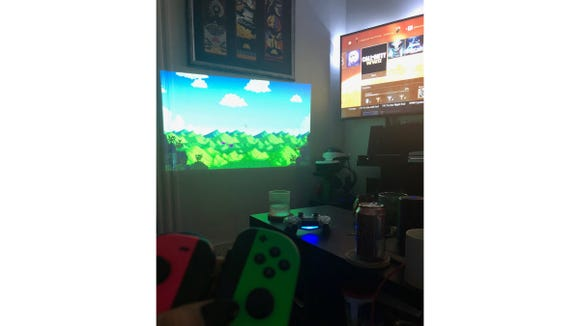 My man and I often use the projector so we can both play our own games together.
