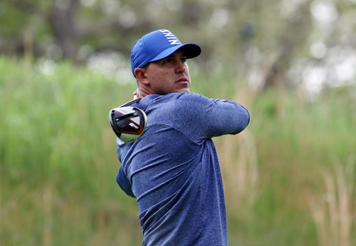 Second round: Brooks Koepka plays his shot from the fourth tee.