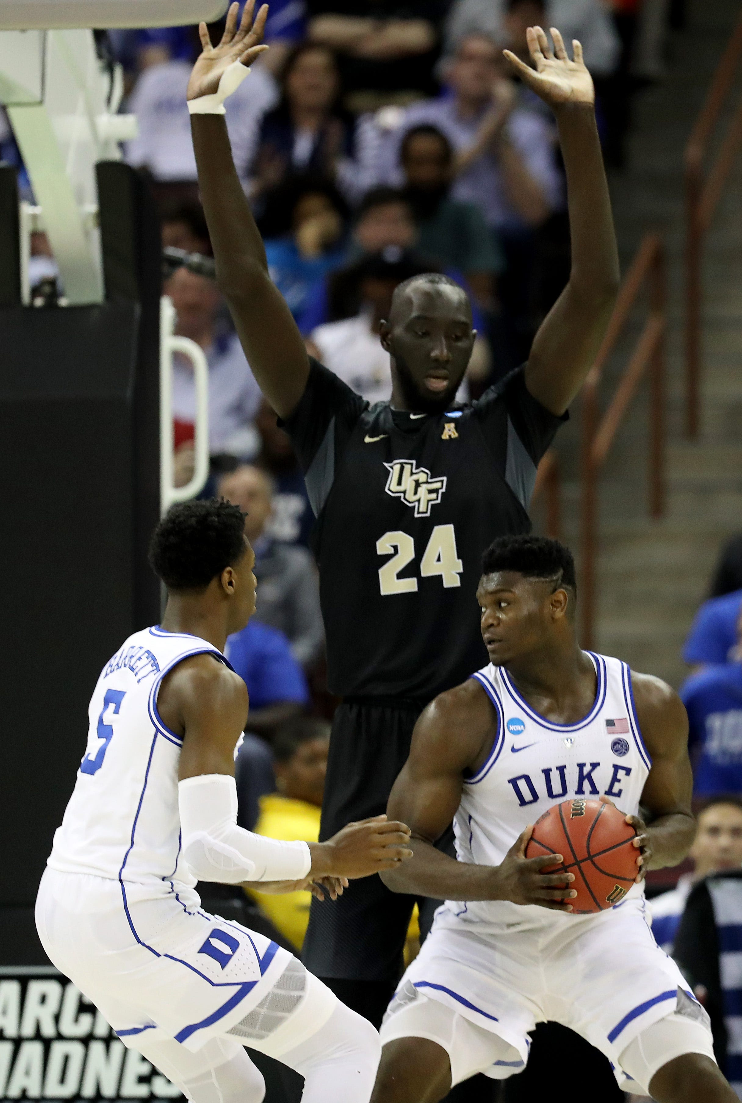 Tacko Fall towers over Zion Williamson during their NCAA tournament second-round game.