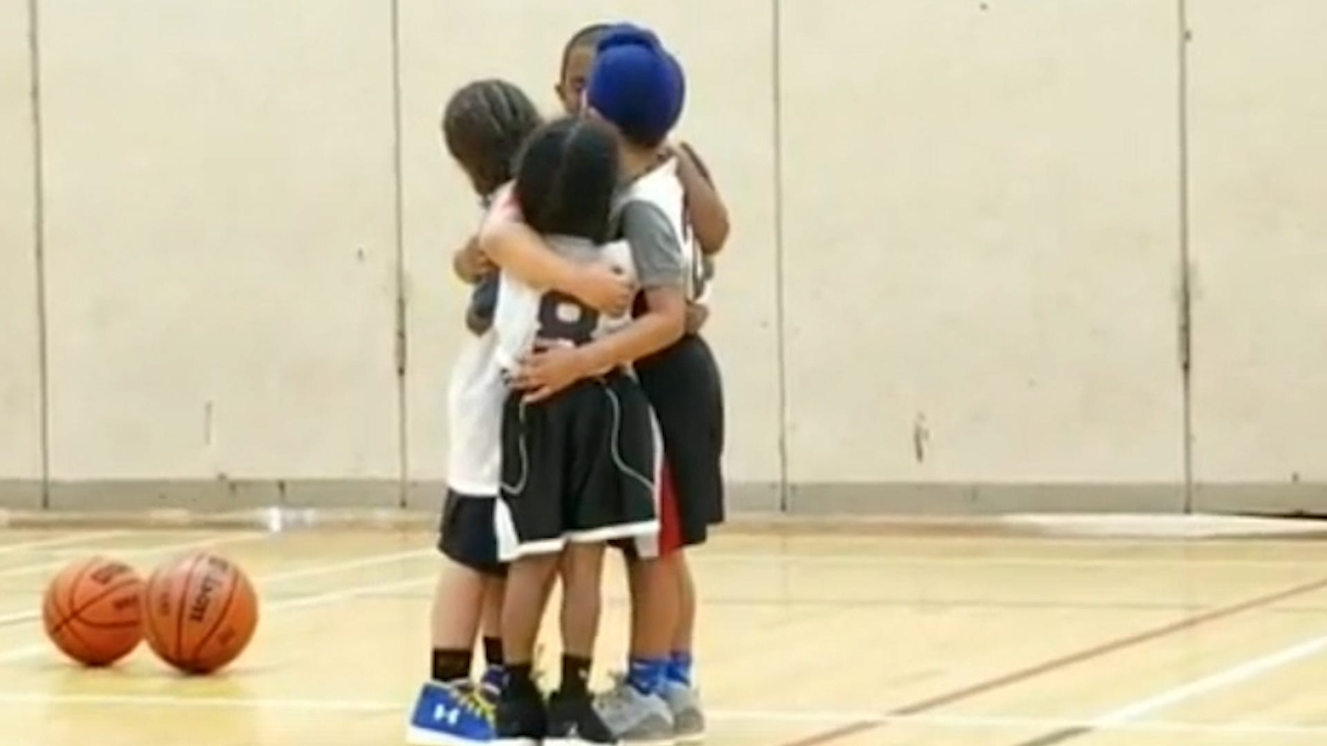 Kids' group hug during basketball game is a huge win