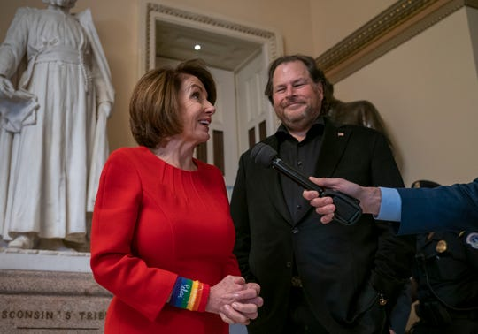 House Speaker Nancy Pelosi, D-Calif., joined by internet entrepreneur Marc Benioff, right, arrives for the vote on The Equality Act of 2019, sweeping anti-discrimination legislation that would extend civil rights protections to LGBT people by prohibiting discrimination based on sexual orientation or gender identity, at the Capitol in Washington, Friday, May 17, 2019.