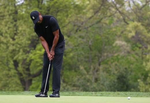 Second round: Tiger Woods putts on the second green.