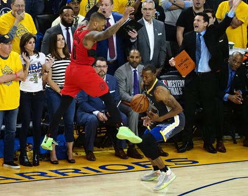 May 16: Warriors defender Andre Iguodala (9) steals the ball from Blazers guard Damian Lillard (0) in the closing seconds of Game 2 to seal GOlden State's win.