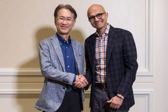 Kenichiro Yoshida, President and CEO, Sony Corporation (left), and Satya Nadella, CEO, Microsoft. The two tech companies are teaming up on the development of cloud gaming systems.