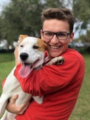 Eckerd college student Colin Hilliard with dog Luna.