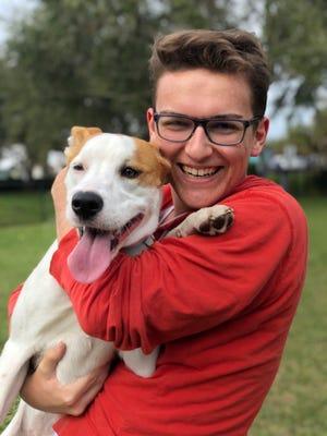 Eckerd college student Colin Hilliard with dog Luna.