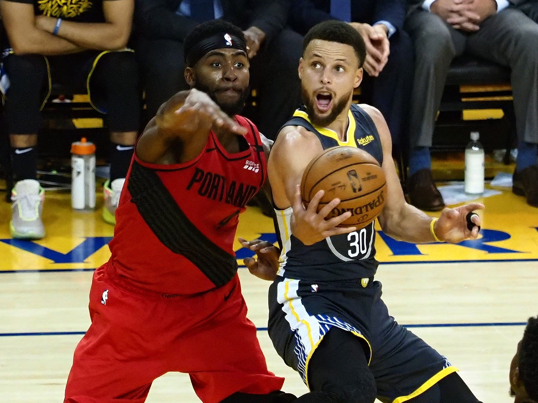 May 16: Warriors guard Stephen Curry (30) drives to the bucket against Blazers defender Moe Harkless (4) during Game 2 in Oakland.
