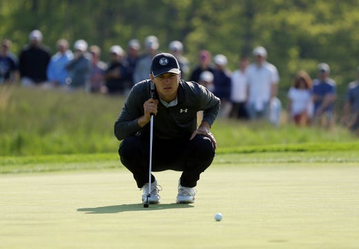 Second round: Jordan Spieth lines up his putt on the 12th green.