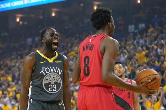 Golden State Warriors forward Draymond Green celebrates.