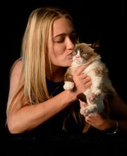 Grumpy Cat, online and publishing feline phenomenon, is seen with her owner Tabatha Bundesen. The famous cat died earlier this week.