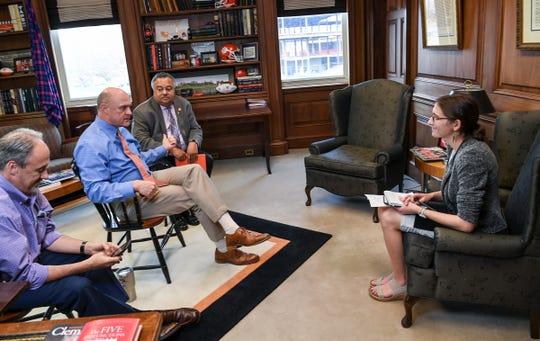 Mollie Simon, right, interviews Clemson President Jim Clements in 2019.