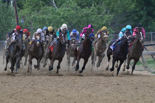 Horses run in the fourth turn during the 144th running of the Preakness Stakes at Pimlico Race Course.