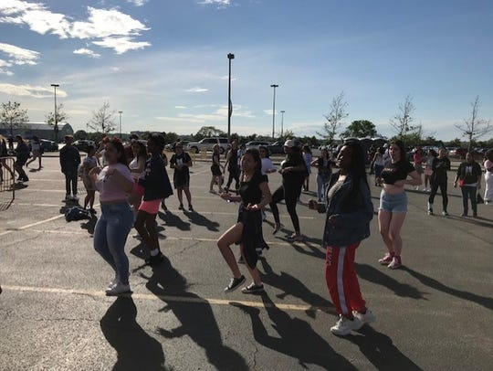 BTS fans dancing in the parking lot of MetLife Stadium on May 18, 2019.