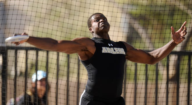 Abilene High's Josh Hunter launches the discus into the air at the Districts 1/2-5A area track meet April 16, 2014, at Lowrey Field in Lubbock.