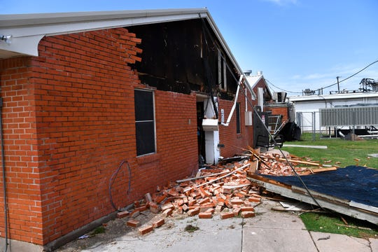 Bricks are piled on the ground where they fell from the rear wall at Willow Springs Health and Rehabilitation Center after Saturday's storm. The residents of the nursing home were evacuated to another facility and none were injured during the storm.