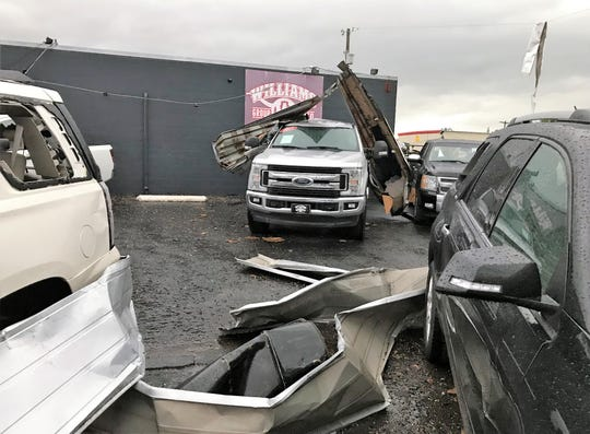 Debris damaged vehicles at the Williams Group Auto lot on South Clack Street during Saturday morning's storm in Abilene. May 18 2019
