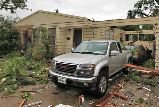 A home in the 300 block of Hawthorne Street lost its roof and sustained other damage during Saturday morning's storm in west Abilene.